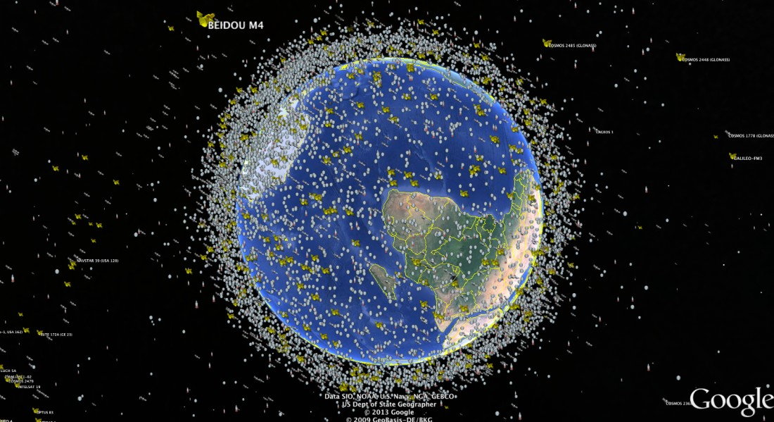 planet Earth surrounded by satellite debris